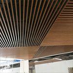 东莞金月湾广场吊顶造型木纹铝方通